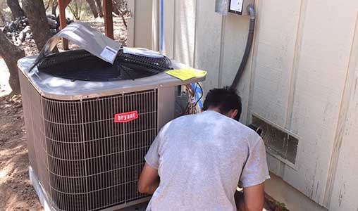 Tracy A/C repair job of a Bryant condenser in progress