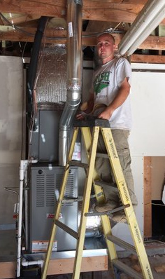 Stockton HVAC repair technician works on a furnace