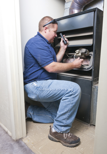 Mike, one of our heating and AC repairs in Lathrop, is doing a routine maintenance check