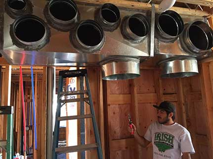 Journeyman contractor installs HVAC system's air ducts in Manteca