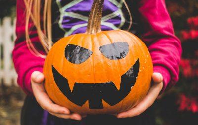 Girl holding a Jack O'Lantern - Family friendly Halloween events in Modesto, California