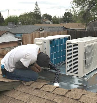 Installing a Mitsubishi Ductless AC system on a rooftop