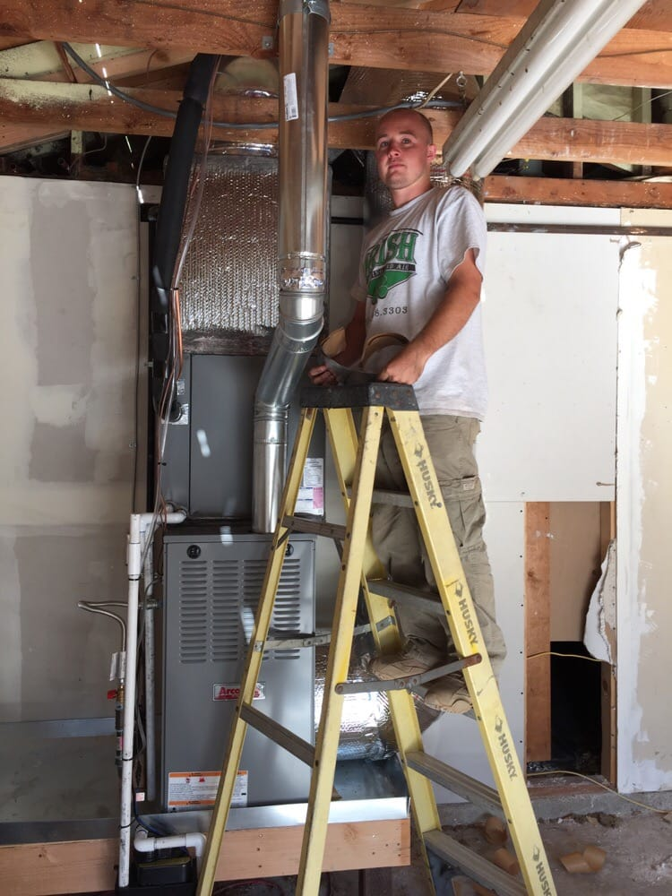 HVAC technician installs Goodman furnace in garage in California's Central Valley