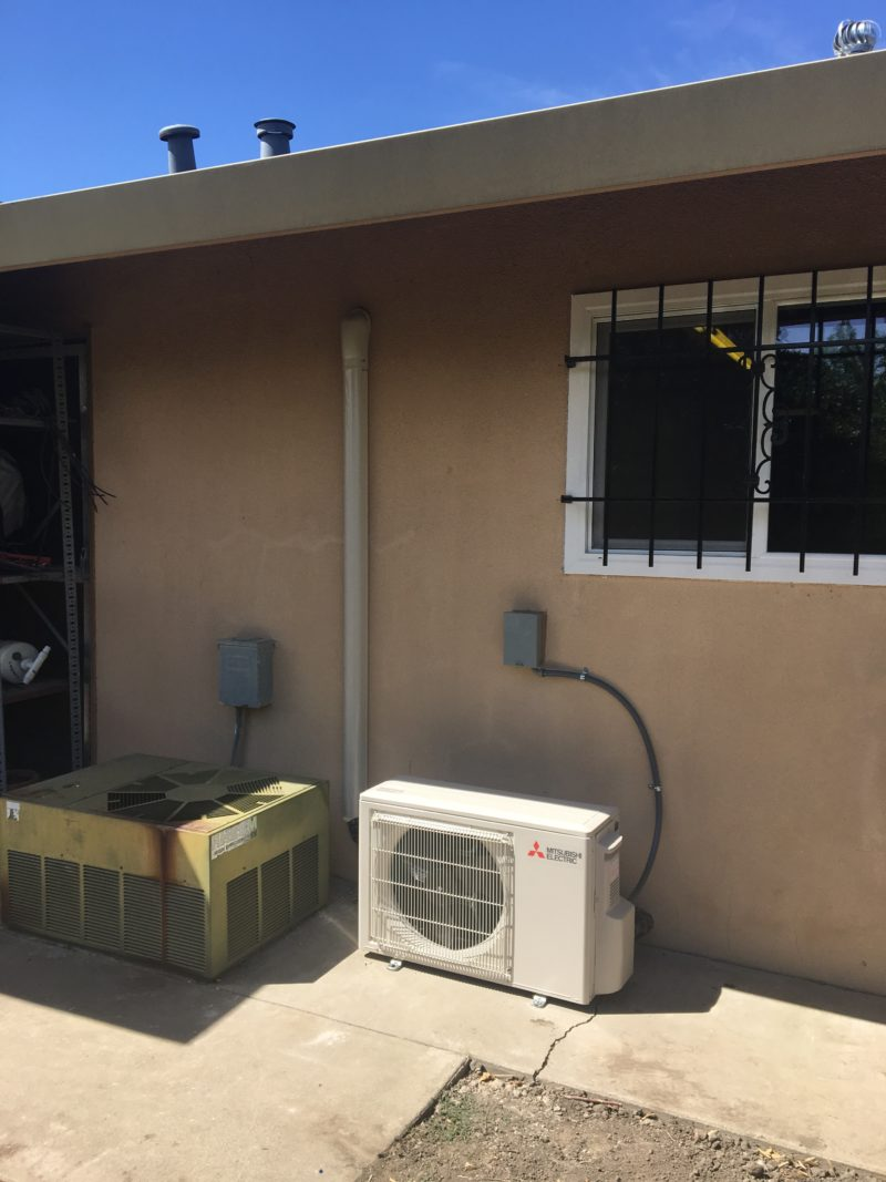 mitsubishi ductless air conditioner installed to the back of a home in tracy california