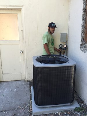 irish heating and air HVAC contractor checking on this residential AC systems refrigerant levels